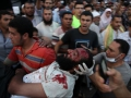 So much for democracy: Morsi supporters carrying a man who was shot and killed by Egyptian security forces during a protest demonstration on July 27 against Morsi's ouster.