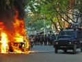 Secular Politics in a Muslim Country: The police used a baton on a protester in Dhaka, as the death toll from violent clashes between protesters and security forces in Bangladesh reached at least 44.