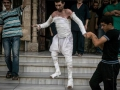 Still strong: A Syrian man with more than half his body burnt from an air strike leaves a field hospital to go back home at a village turned into a battlefield with government forces in Idlib province on September 22.